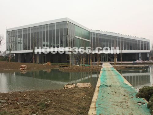 华润国际社区12月进展:售楼中心外立面完工-正内部装修